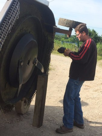 Berea, KY: Repairing farm equipment is part of the farm-to-table experience