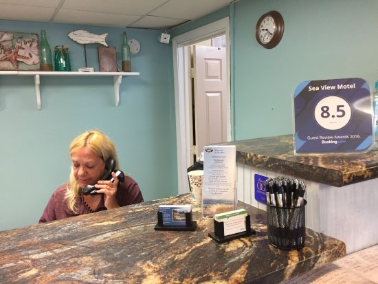 Sea View Motel: Patty taking calls in the office, breakfast area.