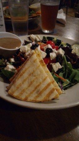 Greek salad with freshly baked flat pita bread