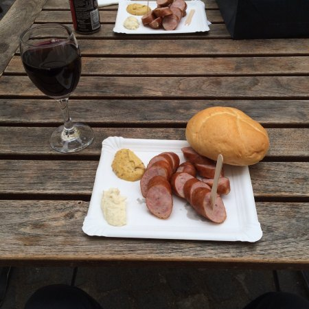 Klobasarna: Fresh cooked sausage on a paper plate - love it!