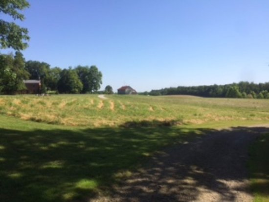 West Union, OH: View from one of the hiking trails across a meadow, dining house on left