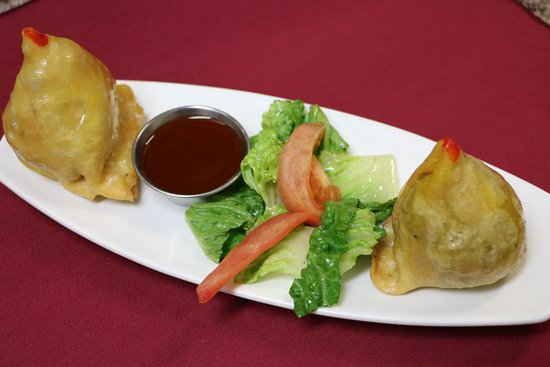 Camrose, Canada: Beef Samosa -Fried stuffed patties with minced Beef and Green peas Served with Tamarind Sauce .