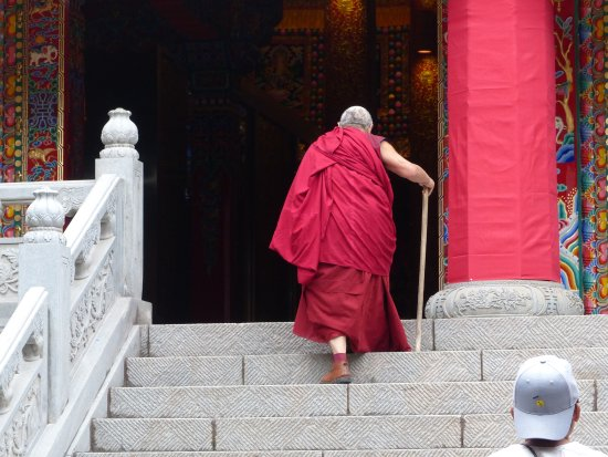 Huangzhong County, China: and old monk, visiting one of the temples