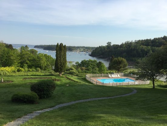 View of grounds and harbor at Asticou Inn