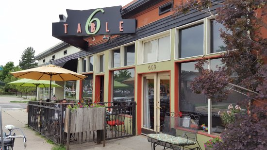 Table Six: outdoor seating and entrance