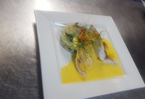 Dinton, UK: Pan roasted sea bass lemon crushed new potatoes saffron and lemon sauce