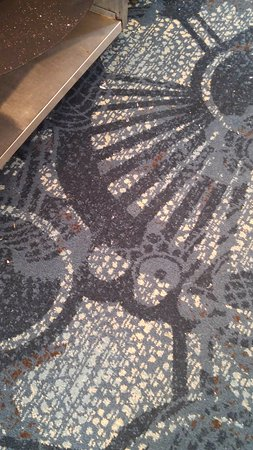 Westlake, OH: Broken glass in the carpeting that was there all weekend.