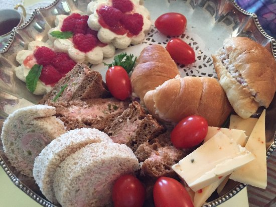 Paris, Canada: tea sandwiches plate but with several missing already eaten - very tasty