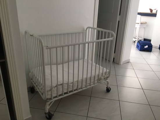 Sapphire Beach Club Resort: Portable crib -- very nice--not just a pack 'n play. We wove towels at the bottom to create a bu