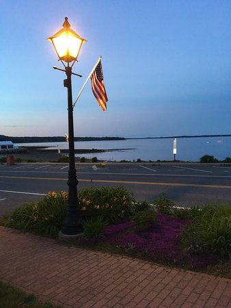 Lincolnville, ME: Flag Day at dusk looking out over the bay from the porch at Spouter Inn Bed & Breakfast. spouter
