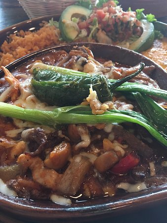 Meridian, ID: MEXICAN Plate- chicken and beef with veggies in a red tomato sauce topped with cheese and a spic