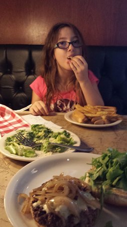 Ted's Montana Grill : burger with blue cheese and sauteed onions , my caesar salad daughter kept stealing, grilled che