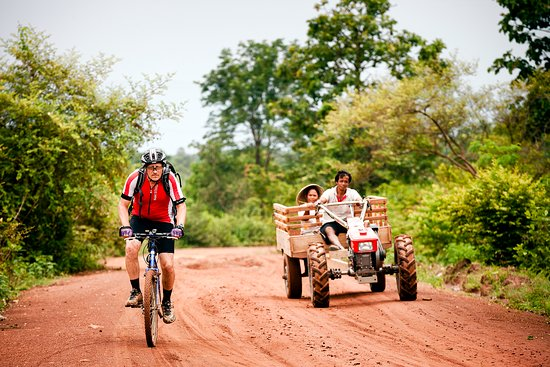 Champasak Province, Laos: Cycling the red dirt roads just outside Pakse