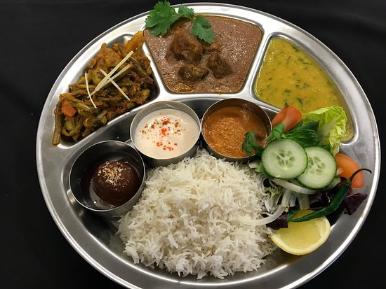 Abergavenny, UK: From the New express lunch menu - Gurkha Thali Vegetable or Non-vegetable, Kathmandu Kothey Momo