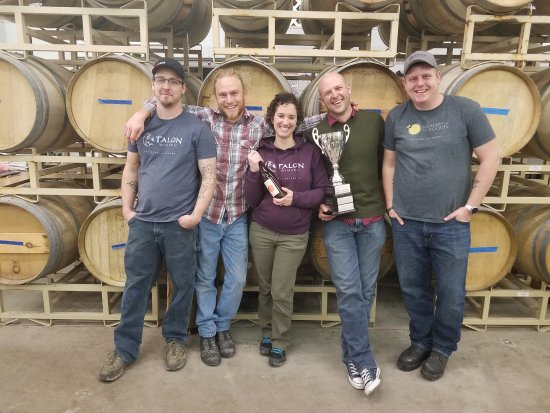 Palisade, CO: The winemaking team with the Governor's Cup for Best-in-Show for our Strawberry Honey Wine