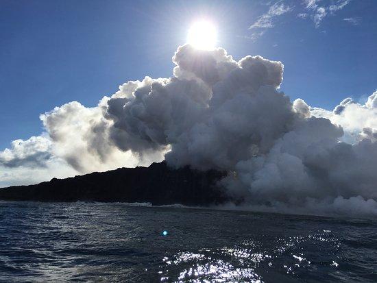 Pahoa, HI: Smoke and steam billow