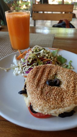 Auroville Bakery : Olive and Cheese bagel with fresh carrot-orange juice!