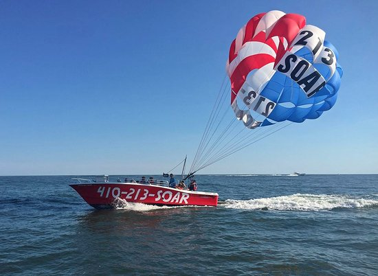 Paradise Watersports: Parasailing in our American Flag on July 4th!
