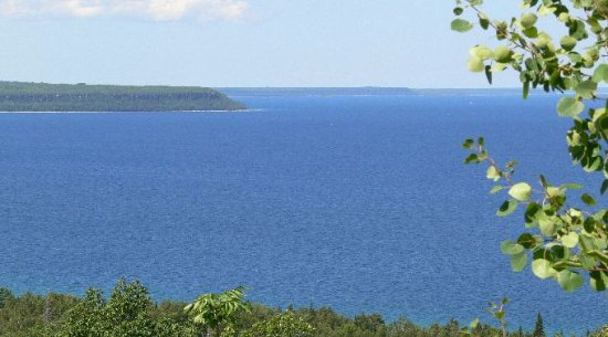 View on to of Greig`s Caves looking up the Bruce Peninsula 300` above the water.