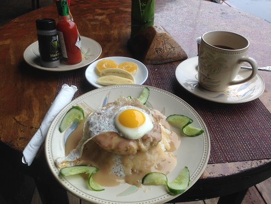 Kosrae, Federated States of Micronesia: Breast fast on another day. I tried fishcake on rice. The gravy is delicious.