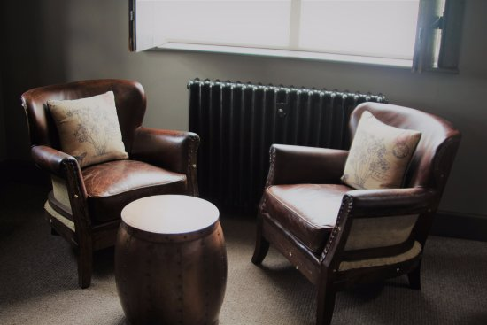 The French Rooms: Casual seating in the 'Parisian' bedroom.