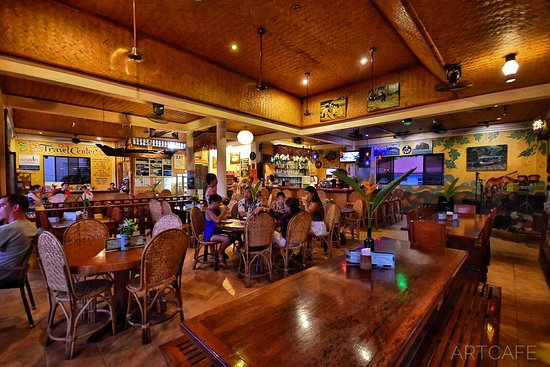 The best El Nido restaurants - Shows the interior of Artcafe restaurant