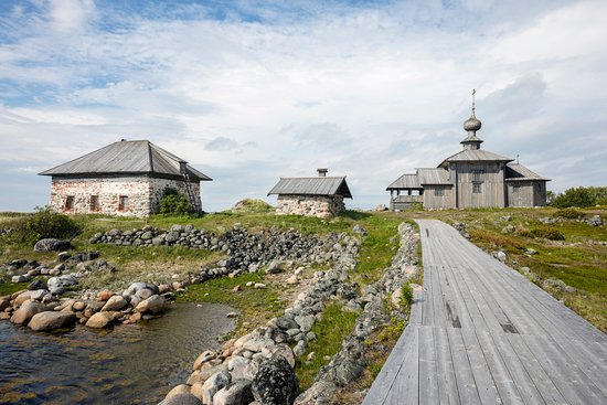 St. Andrew's Church (wooden, right) and stone storage structures, Bolshoi Zayatsky Island (2016)