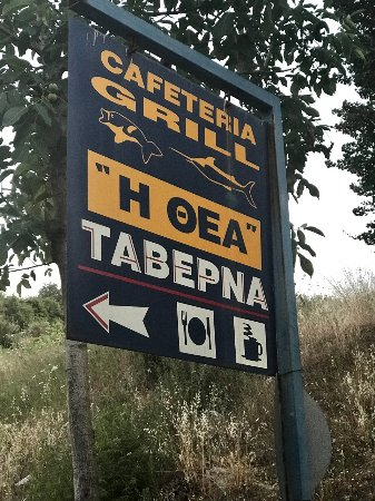 I Thea : Roadside sign across the street from the taverna