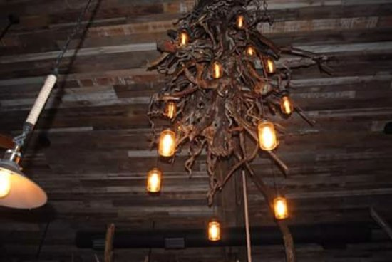 Custom made tree root chandelier picture of carmelinas italian carmelinas italian bistro custom made tree root chandelier aloadofball Choice Image