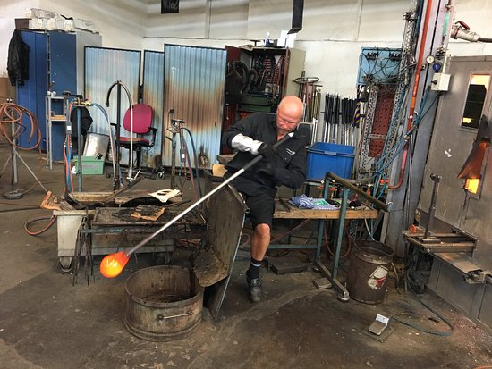 Kosta glass artisan blowing glass