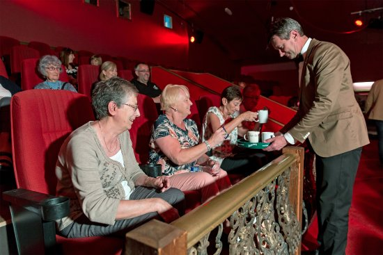 Ebbw Vale, UK: Regulars enjoying a cup of tea brought to their seats.