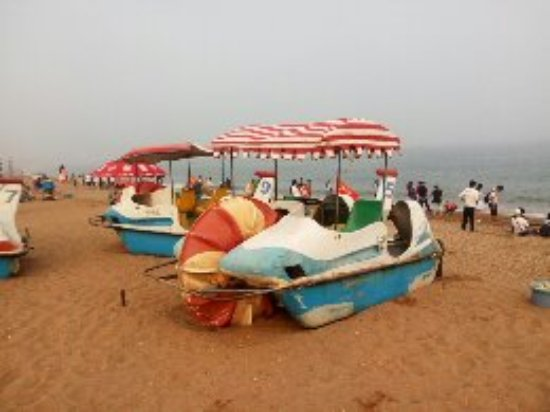 Dalian, China: Old pedal boats are kept on the beach as souvenirs