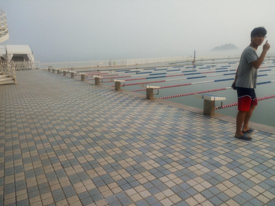 Dalian, China: Olympic size pool with the Yellow Sea and islands as a backdrop