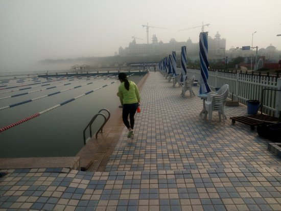 Dalian, China: The new Hilton in the mist behind the big pool on the beach