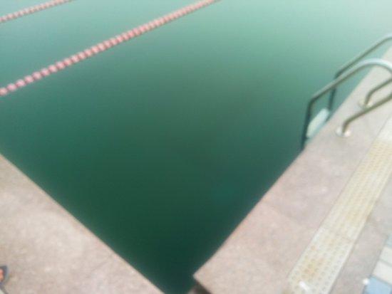 Dalian, China: Seawater fills the pool by the beach