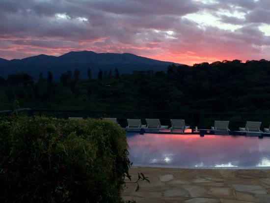 Neptune Ngorongoro Luxury Lodge: Suset over the pool