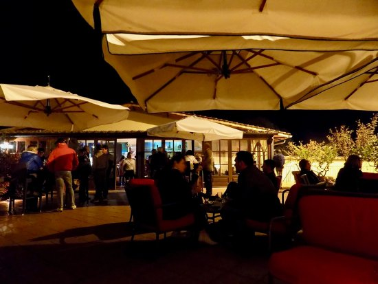 Vagliagli, Italy: Relaxing outside the bar.