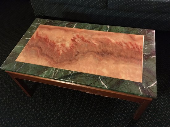 Americas Best Value Inn: coffee table encapsulates the color palette of the room -- dark greens and warm orange-reds