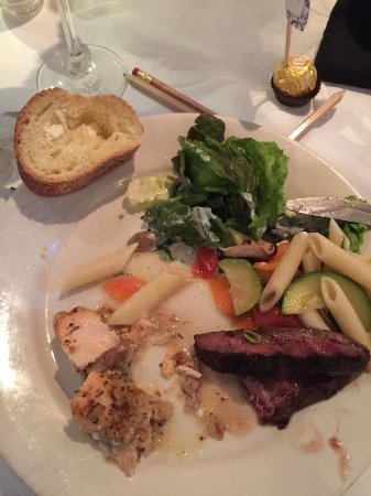 Rockville Centre, NY: Array of food during a Bridal Shower buffet including steak and salmon