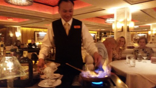 The Steak House at Western Village: Our server making Banana Foster!