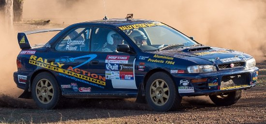 Dowerin, Australia: Rally driving sideways in a Turbo Subaru WRX Rally Car