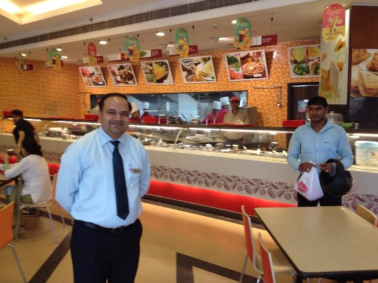 Behror, India: The dispensing counters and the very friendly and helpful Manager. Continuously on the rounds.
