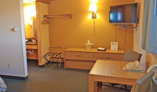 A-B-C Motel: View of TV, dresser and desk