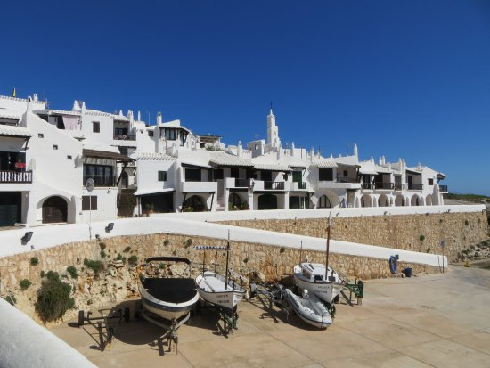 TUI SENSIMAR Eden Binibeca by Vanity: The quaint apartment complex opposite the hotel. Note the boats on the ramp that slopes to the s