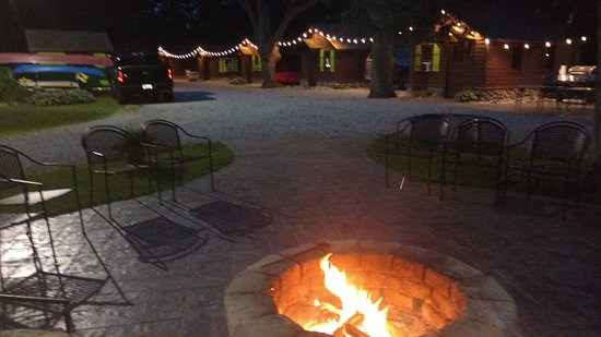 Honor, MI: The front drive of the Pines, lit by our patio lights, and with a warm inviting fire.