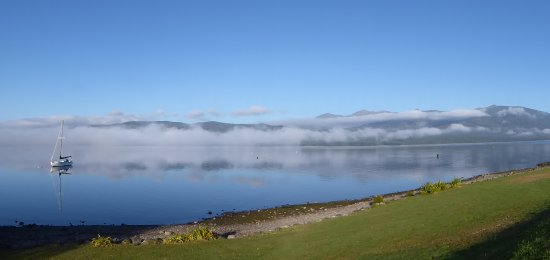 Lakefront Lodge : An early morning view of the lake taken from the driveway