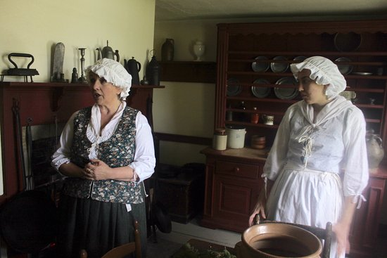 Sydney, Canada: Mrs. Cossit and one of her daughters cooking some soup broth and worrying about the boys.