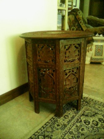 DeLand, FL: Octagonal carved side table from India. Can be folded down for transportation.