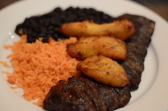 Little Ferry, NJ: skirt steak with plantains, rice and black beans . so good and the steak is tender and easy to c