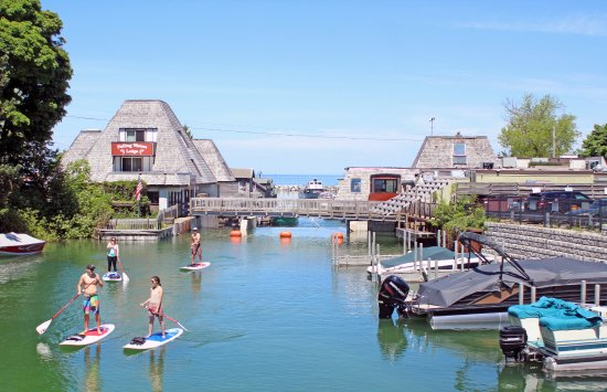 Suttons Bay, MI: Leland Paddleboard Tour with Fishtown backdrop